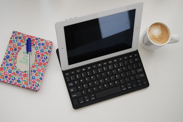 Pen, notepad latte and tablet