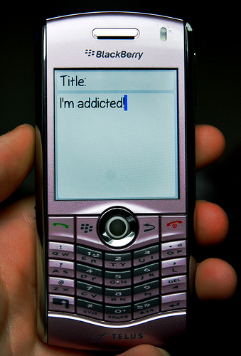Blackberry phone showing chat messge - I'm addicted'