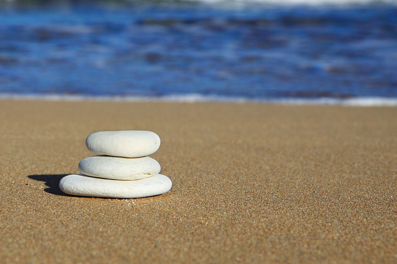 Pebbles on beach - YouthyHub.com image post on Love in Islam